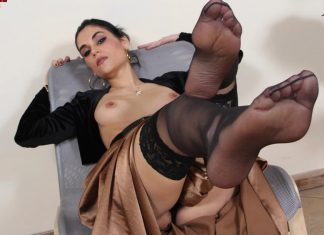 Mouthwatering Chiara smokes a cigarette and takes off her stockings